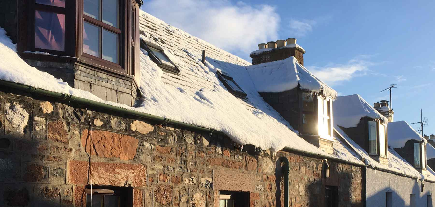 Snow on traditional roofs