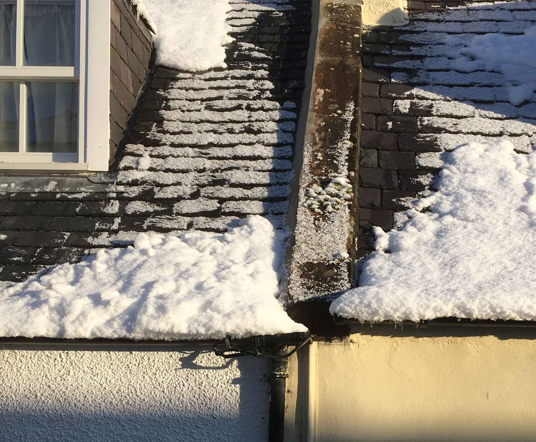 Snow resting on gutters causing them to distort