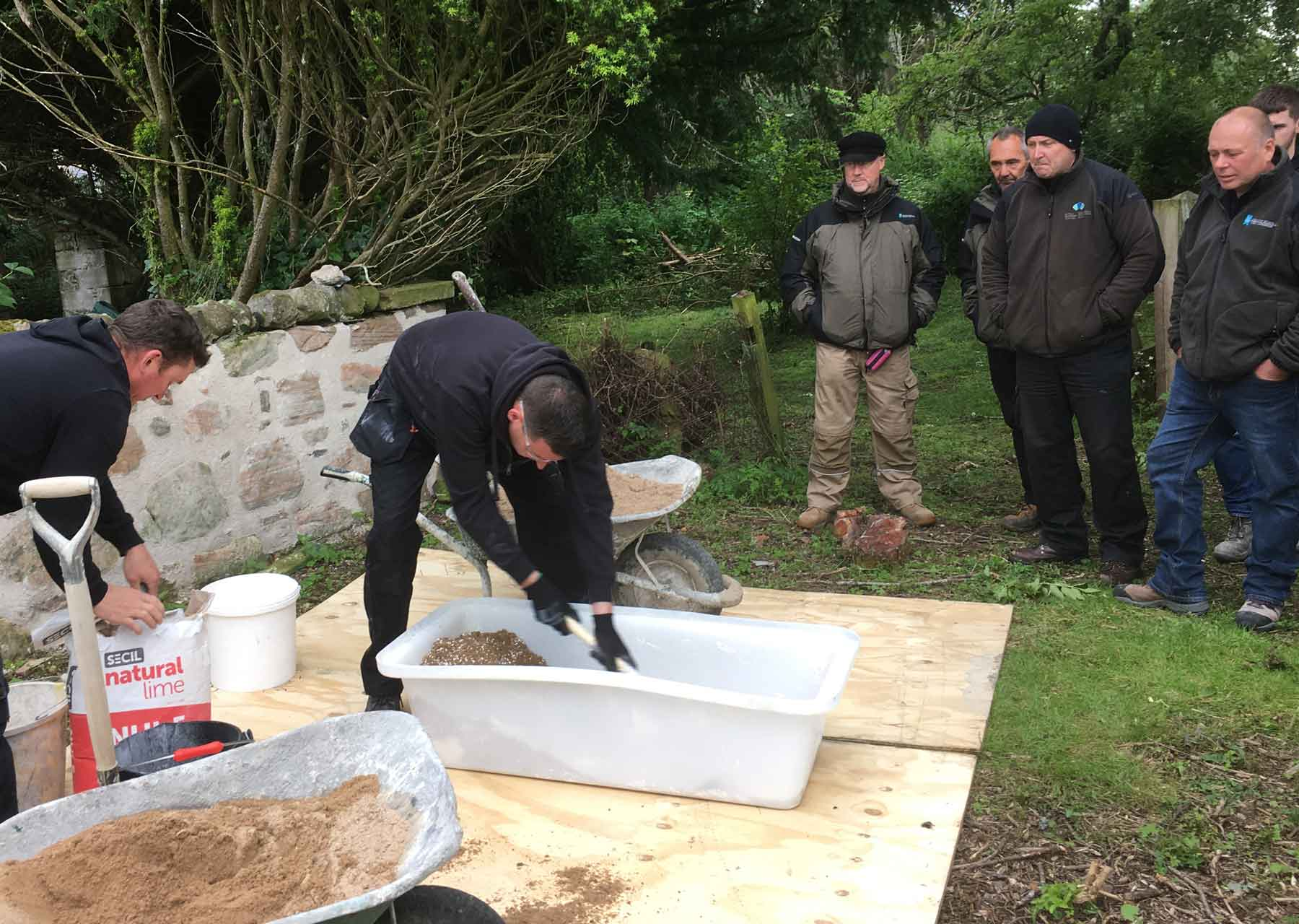 Craig Frew demonstrating a gauged hot lime mix at St Johns Chapel new Inverness